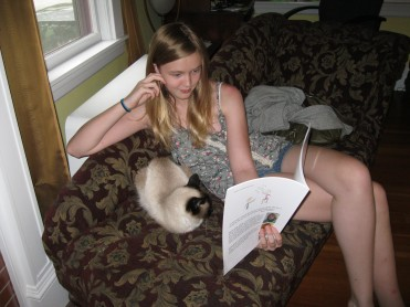 Katrina reads to Beanie, our 17 year old cat.